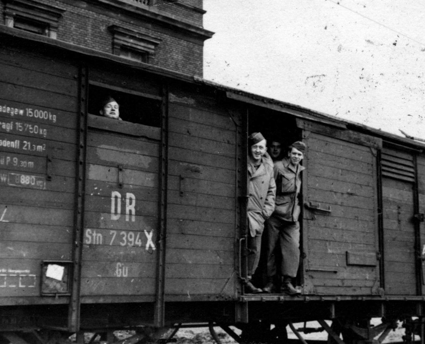 "GIs aboard a ""forty and eight"" boxcar in Germany"